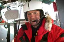 Allan flying over the Ross Sea by helicopter