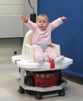 An infant seats on a mobile robot