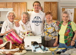 Chris Friedlander '15 and the ladies in the Quilting circle at Longview