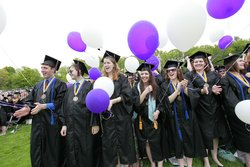 Graduates with balloons