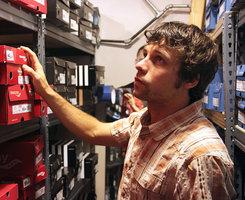 Ian Golden '99 in his store