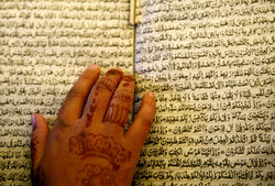 Image of woman reading the Quran