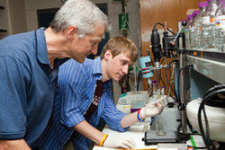 In Andy Smith�s lab, biochemistry major Matt Zeitler �10 (right) analyzes the molecular composition of slug slime. He has identified a protein in a lo