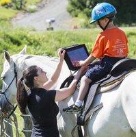 Maritsa and a student with an iPad
