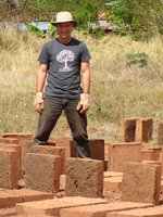 Michael Smith stacking adobe bricks!