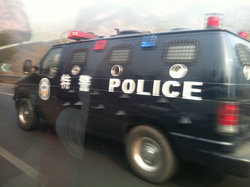 On the way to the Great Wall, we saw a police van. Notice the spikes protruding from its door--yikes!