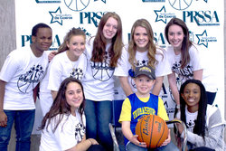 PRSSA e-board poses with wish kid, Danny Durling