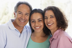 Parents and student smiling