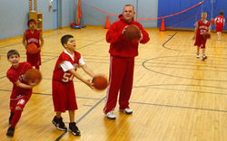 Sean Walsh with Kids on Basketball Court