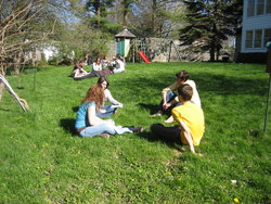 Students discussing a simulation in my backyard.