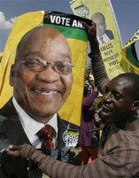 Supporters celebrate around Zuma poster (2009) (AP Photo)