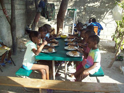 children eating in an orphanage prior to quake
