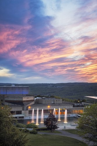 A sunset view of the fountains and Dillingham Center.