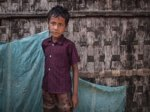 A youth in a displacement camp for Rohingya Muslims, an ethnic minority in Myanmar.