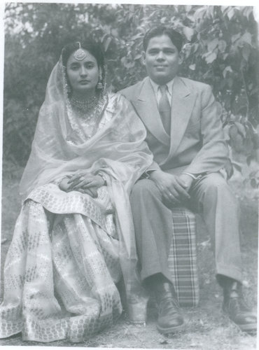 picture of my parents on their wedding; sitting down.