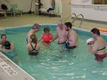 Students provide therapy in the pool along with faculty advisor