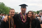 Doug Indrick, Hayden ort-Ulm and Stephanie Piech posing in their cap and gowns