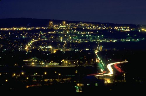 Downtown Ithaca at night, Ithaca College's Towers near the horizon