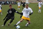 Ithaca senior forward Kurt Odenbach battles against Hopkins senior Matt Carson.