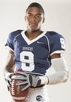 Malik Morris in his IC football uniform holding a football