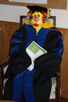 striped tiger in blue commencement robe