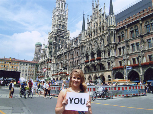 "Kendra holding ""You"" sign"