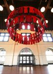 2008; 35' x 24' x 24', variable dimensions; wood hoops, red dresses, parachute cord, hardware; site: train depot great hall, Duluth, Minnesota