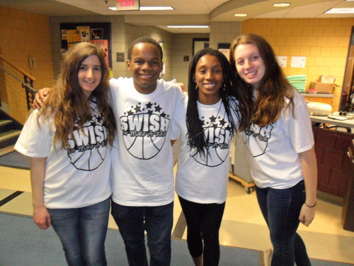 Student volunteer Marissa Torcivi and PRSSA e-board members Carter Smalley, Dominique Brown and Lauren Quigley enjoy Swish for Make-A-Wish on April 20 in the Fitness Center Mondo Gym on Ithaca College