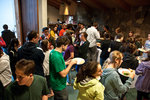 Students packed into Muller Chapel for Hillel's annual welcome back BBQ because of bad weather.