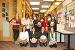 A group of students holding tabla drums