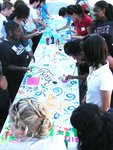 students painting a mural