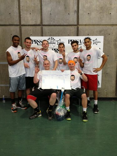 The wining team members of the Pro bracket, 99 Problems But a Pitch Ain�t One, pose with their winning basket.