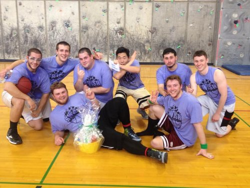 The wining team members of the Semi-Pro bracket, Seymour Butts, pose with their winning basket.
