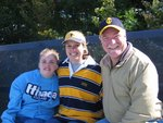 Emily, Rory Lyons (2007 Scholarship Awardee) and Steve Kimmons at a football game.