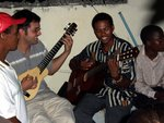 A Dominican and an American playing guitar