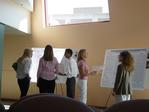 Ithaca students and faculty talk at the poster session