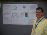 Mark Hedglin in front of his poster
