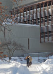 Students walk in the bright, winter sun in front of Gannett Center.