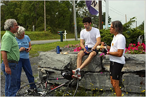 Steve and Chris Zinder (left) check on their son Adam as he takes a break from riding to grab some ice cream and chat with fellow rider and IC associate professor of writing Jerry Mirskin.