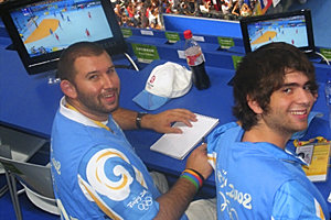 Cory Francer '10, and Stephen Keller '09 take notes at the Olympic handball gold medal match.