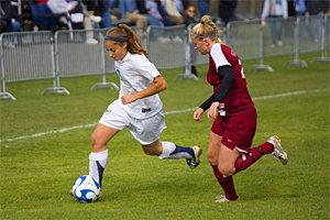 Ithaca forward Chelsey Feldman '09 breaks upfield against a Vassar defender.