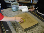 Student processing a lithographic stone