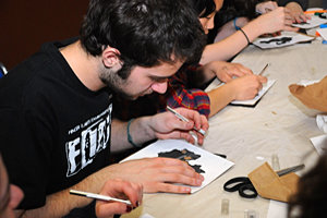 Festival intern Daniel Sitts '12 tries his hand at Chinese paper cutting during a FLEFF lab.