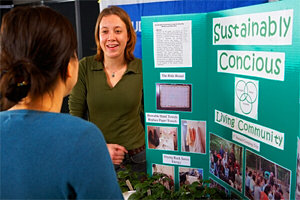 A member of the Sustainably Conscious Living Community makes a presentation at Campus Sustainability Day.
