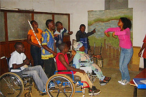 Associate professor Henderson working with a theater for the disabled.
