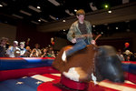 First-year exploratory major Dan Tappan hangs on tight at the IC After dark's Urban Cowboy event.