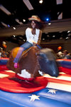 First-year exploratory student Sydney Southers goes for a ride on the mechanical bull.