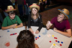 First-year students Ryan Butler (outdoor adventure leadership), Dana Pavelsky (exploratory), and John Mcglaughlin (history) test their luck at the Urban Cowboy poker tables.