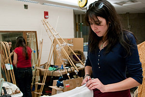 Madison Ryckman '11, working in the costume shop in IC's Dillingham Center. Photo by Martha Pace '12