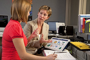 Laura Badger, M.S.'10, confers with clinical instructor Tina Caswell. Photo by Bill Truslow